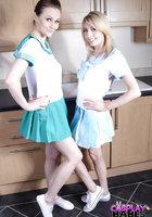 Две морячки в униформе занимаются лесбийским сексом на кухне 1 фотография